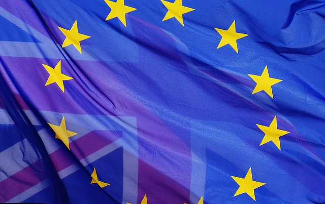The European Union flag with the Union Jack showing through it