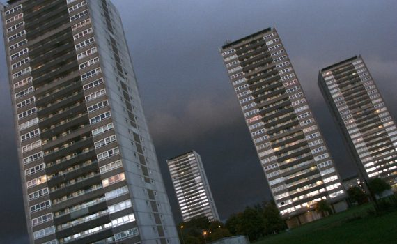 Several high-rise blocks with a cloudy dusk sky.