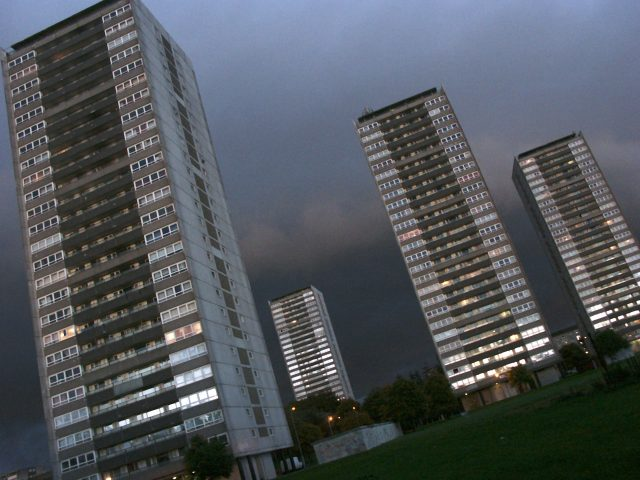 High-rise blocks. Glasgow housing scheme, with cloudy dusk sky.