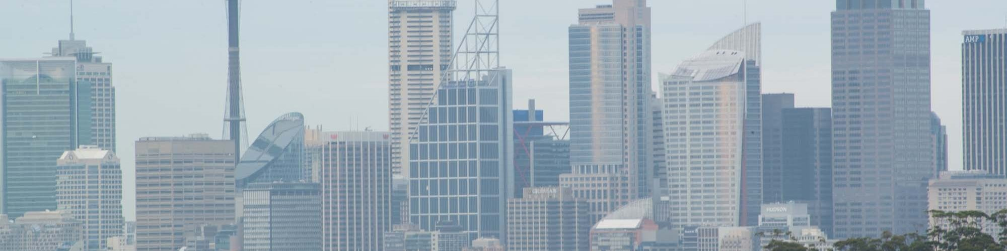City skyline with skyscrapers and a line of housing in the foreground