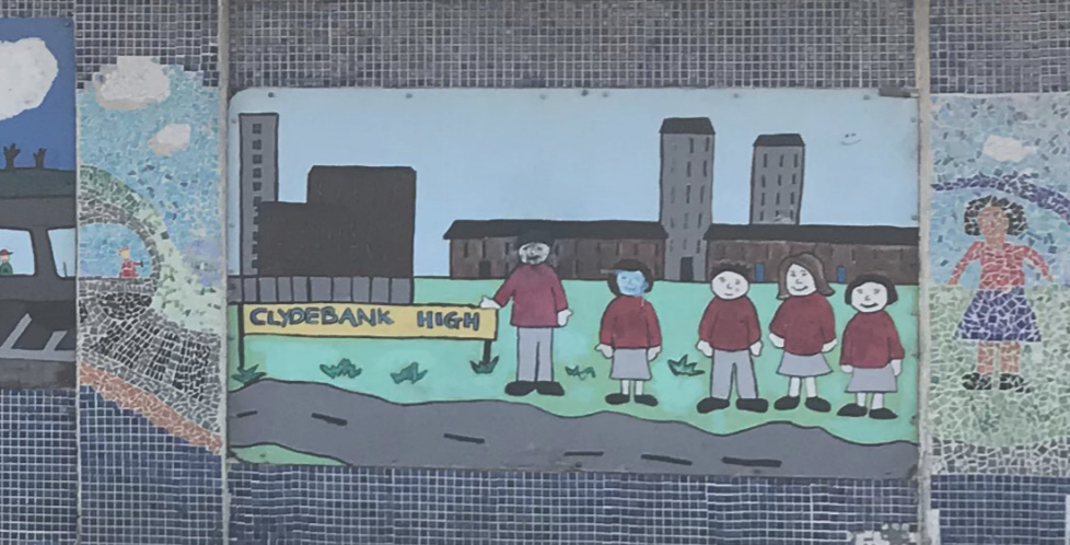 A mural by school pupils showing five pupils in maroon sweatshirts and grey skirts and trousers at Clydebank High School