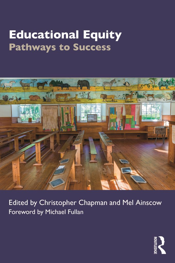 Cover of the book 'Educational Equity. Pathways to Success. Edited by Christopher Chapman and Mel Ainscow. Foreword by Michael Fullan', with a photo of the 19th century classroom at New Lanark in Scotland with wooden desks and benches, slates and paintings of animals on the walls, and the Routledge logo