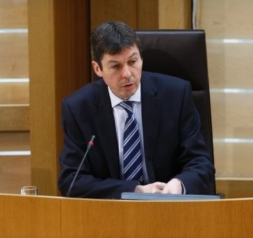 Ken Macintosh at the Presiding Officer's desk and chair in the Scottish Parliament