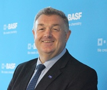 Head and shoulders photo of Geoff Mackey smiling with the BASF logo in the background